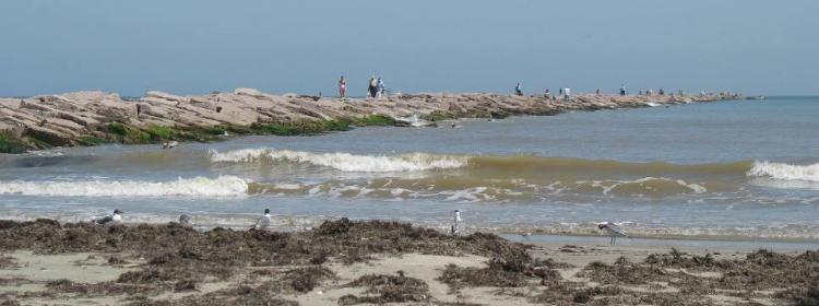 The jetty protecting aransas pass for Aransas pass fishing
