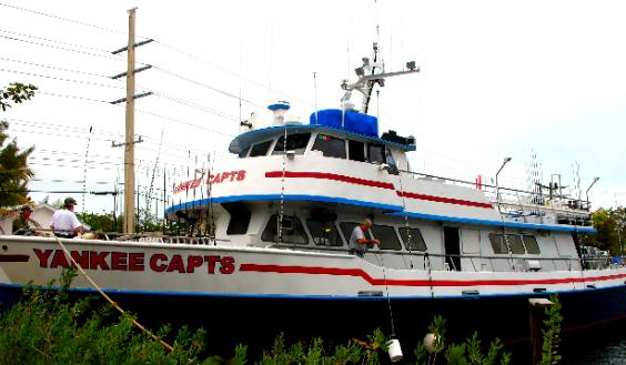 Yankee capts party fishing boat at dock on stock island for Yankee captains fishing